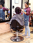 WATERBURY CT. - 27 December 2019-1227SV07-Arixsa Vargas, owner, works on a customer's hair at Maria's Hair Styling Salon on South Main Street in Waterbury Friday. <br /> Steven Valenti Republican-American