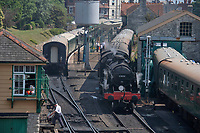 BNPS.co.uk (01202 558833)<br /> Pic: ZacharyCulpin/BNPS<br /> Date taken: 22/07/2021<br /> <br /> Pictured: The 1920's U Class steam locomotive at Swanage Railway station<br /> <br /> Weather input<br /> <br /> If you think your office is hot spare a thought for Swanage Railway fireman Jon Cooper. Jon has to deal with temperatures of up to 45 degrees as he shovels coal into the fire of a 1920's U Class steam locomotive<br /> <br /> It's a busy time of year for the heritage railwayline as holiday makers enjoy 5 mile trips by the Dorset coast which can startfrom Norden to Corfe Castle and down to the Victoria seaside town of Swanage (pictured)