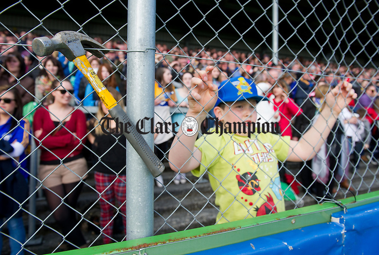 Clare may not have hammered Galway as they did Waterford last week, but nonetheless a claw hammer was to be seen on the wire as a young fan kept an eye on all the action during the NHL Division 1 Round 5 game against Galway at Cusack park, Ennis. Photograph by John Kelly.