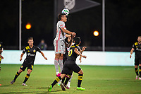 LAKE BUENA VISTA, FL - JULY 16: Aaron Long #33 of the New York Red Bulls heads the ball during a game between New York Red Bulls and Columbus Crew at Wide World of Sports on July 16, 2020 in Lake Buena Vista, Florida.