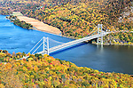 View of the Bear Mountain Bridge from the top of Bear Mountain Park on a fall day.
