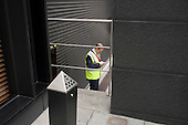 Security guard outside an office building, Gresham Street, City of London.