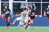 FOXBOROUGH, MA - JULY 25: Matt Polster #8 of New England Revolution moves to block Joaquín Torres #18 of CF Montreal near the New England Revolution goal during a game between CF Montreal and New England Revolution at Gillette Stadium on July 25, 2021 in Foxborough, Massachusetts.