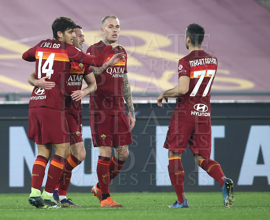 Football, Serie A: AS Roma - Cagliari calcio, Olympic stadium, Rome, December 23, 2020. <br /> Roma's Jordan Veretout (second left) celebrates after scoring with his teammates during the Italian Serie A football match between Roma and Cagliari at Rome's Olympic stadium, on December 23, 2020.  <br /> UPDATE IMAGES PRESS/Isabella Bonotto