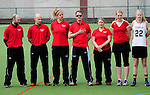 FRANKFURT AM MAIN, GERMANY - April 14: German head coach Damien Orr, assistant coaches Christoph Rapp and Anna Sody, team manager Douglas Kisinger Thompson, Sabine Paul, Astrid Hoffmann and Tessa Helf #22 of Germany during the national anthem before the Deutschland Lacrosse International Tournament match between Germany vs Great Britain during the on April 14, 2013 in Frankfurt am Main, Germany. Great Britain won, 10-9. (Photo by Dirk Markgraf)