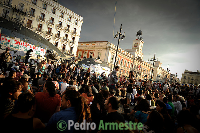 "Thousands of demonstrators gather on the Puerta del Sol square in central Madrid on June 5, 2011 during a protest to decry mainstream political parties, soaring unemployment, corruption and welfare cuts. The leading protest group known as ""the indignants"" met today to decide whether to carry on their camp-out against political corruption and joblessness. (c) PEDRO ARMESTRE"