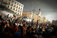 """Thousands of demonstrators gather on the Puerta del Sol square in central Madrid on June 5, 2011 during a protest to decry mainstream political parties, soaring unemployment, corruption and welfare cuts. The leading protest group known as """"the indignants"""" met today to decide whether to carry on their camp-out against political corruption and joblessness. (c) PEDRO ARMESTRE"""