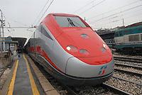 """- high-speed train Eurostar """"Red Arrow"""" at Bologna station....- treno ad alta velocità Eurostar """"Freccia Rossa"""" alla stazione di Bologna"""