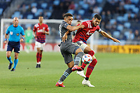 SAINT PAUL, MN - MAY 15: Hassani Dotson #31 of Minnesota United FC and Matt Hedges #24 of FC Dallas battle for the ball during a game between FC Dallas and Minnesota United FC at Allianz Field on May 15, 2021 in Saint Paul, Minnesota.