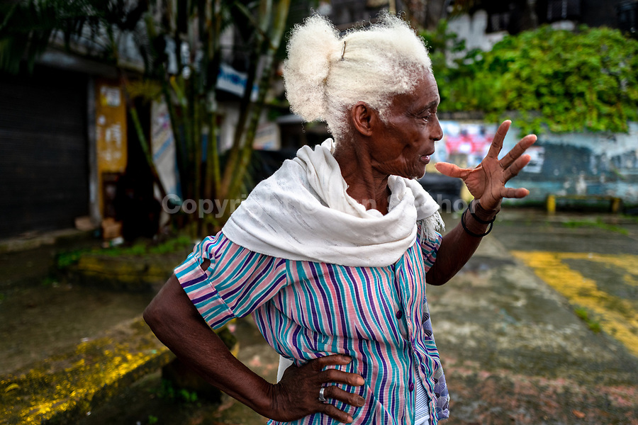 An Afro-Colombian fruit vendor talks about her work in the river market in Quibdó, Chocó, the Pacific department of Colombia, 8 October 2019.