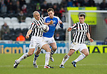 St Mirren v St Johnstone.....02.02.13      Scottish Cup.Steven MacLean is closed out by Jim Goodwin and Paul McGowan.Picture by Graeme Hart..Copyright Perthshire Picture Agency.Tel: 01738 623350  Mobile: 07990 594431