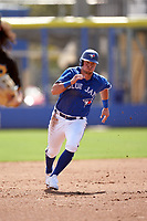 Toronto Blue Jays Joe Panik (2) running the bases during a Major League Spring Training game against the Pittsburgh Pirates on March 1, 2021 at TD Ballpark in Dunedin, Florida.  (Mike Janes/Four Seam Images)