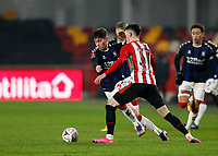 9th January 2021; Brentford Community Stadium, London, England; English FA Cup Football, Brentford FC versus Middlesbrough; Hayden Hackney of Middlesbrough challenged by Alex Gilbert of Brentford