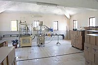 The new winery building with the bottling machine. Cobo winery, Poshnje, Berat. Albania, Balkan, Europe.