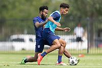 FRISCO, TX - JULY 20: Eryk Williamson, Nicholas Gioacchini battle for a ball during a training session at Toyota Soccer Center FC Dallas on July 20, 2021 in Frisco, Texas.