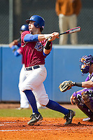 Brandon Paul (14) of the Presbyterian Blue Hose follows through on his swing against the High Point Panthers at the Presbyterian College Baseball Complex on March 3, 2013 in Clinton, South Carolina.  The Blue Hose defeated the Panthers 4-1.  (Brian Westerholt/Four Seam Images)