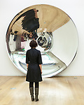 """© Joel Goodman - 07973 332324 - all rights reserved . 03/03/2011 . Manchester , UK . A woman explores works by Anish Kapoor at the premiere of """"Flashback"""", a new exhibition of his work, in Manchester. The exhibition, at Manchester Art Gallery, is the first the artist has held outside of London in over a decade and opens on the 5th of March . Photo credit : Joel Goodman"""