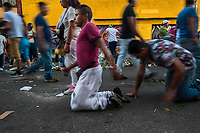 Mexican devotees of Santa Muerte (Holy Death) crawl on their knees during a religious pilgrimage in Tepito, a violent neighborhood of Mexico City, Mexico, 1 April 2018. The religious cult of Santa Muerte is a fusion of Aztec death worship rituals and Catholic beliefs. Born in lower-class neighborhoods of Mexico City, it has always been closely associated with crime. In the past decades, original Santa Muerte followers, such as prostitutes, pickpockets and street drug traffickers, have merged with thousands of ordinary Mexican Catholics. The Holy Death veneration, offering a spiritual way out of hardship in modern society, rapidly expanded. Although the Catholic Church still considers Santa Muerte followers the devil worshippers, on the first day of every month, crowds of Santa Muerte believers fill the streets of Tepito. Holding statues of Holy Death clothed in a long robe, they pray for healing, protection, money or any other favor in life.