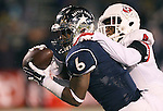 Nevada's Don Jackson (6) catches a scoring pass against Fresno State's Shannon Edwards (4) during the first half of an NCAA college football game in Reno, Nev., on Saturday, Nov. 22, 2014. (AP Photo/Cathleen Allison)