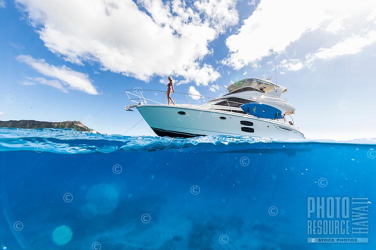 Women enjoy the day on a power cruiser off of Waikiki, O'ahu.