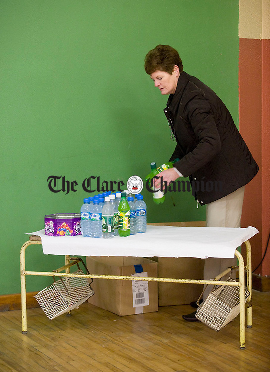 Mary Peppar setting up the mineral stall at the Feakle Parish Afternoon Tea Social in the local Hall. Photograph by John Kelly.
