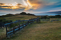 Rustic Fence through Black Point meadow at sunset at The Sea Ranch