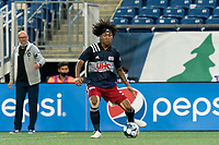 FOXBOROUGH, MA - AUGUST 7: Isaac Angking #5 of New England Revolution II passes the ball during a game between Orlando City B and New England Revolution II at Gillette Stadium on August 7, 2020 in Foxborough, Massachusetts.