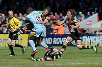 Nick Evans of Harlequins tackles Luther Burrell of Northampton Saints with help from Luke Wallace of Harlequins during the Aviva Premiership match between Harlequins and Northampton Saints at the Twickenham Stoop on Saturday 4th May 2013 (Photo by Rob Munro)