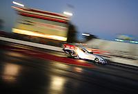 Jan 25, 2009; Chandler, AZ, USA; NHRA funny car driver Mike Neff races down track during testing at the National Time Trials at Firebird International Raceway. Mandatory Credit: Mark J. Rebilas-
