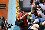 Canadian tennis player Milos Raonic signs autographs after winning Madrid Open Tennis 2014 match. May 06, 2014. (ALTERPHOTOS/Victor Blanco)
