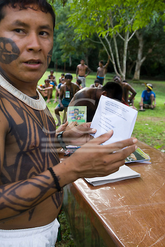 """Altamira, Brazil. """"Xingu Vivo Para Sempre"""" protest meeting about the proposed Belo Monte hydroeletric dam and other dams on the Xingu river and its tributaries. Indian camp at Bethania seminary. Young Yudja leader prepares a statement."""