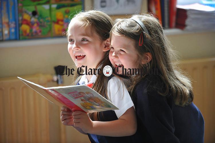 Ella Bella Cantillon and Phoebe Lenharth share a book  at Killaloe Convent Primary School. Photograph by John Kelly.