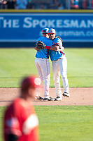 Spokane Indians infielders Jax Biggers (1) and Cristian Inoa (4) embrace after clinching the Division title after a Northwest League game against the Vancouver Canadians at Avista Stadium on September 2, 2018 in Spokane, Washington. The Spokane Indians defeated the Vancouver Canadians by a score of 3-1. (Zachary Lucy/Four Seam Images)