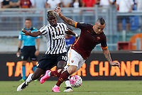 Calcio, Serie A: Roma vs Juventus. Roma, stadio Olimpico, 30 agosto 2015.<br /> Roma's Radja Nainggolan, right, is challenged by Juventus' Paul Pogba during the Italian Serie A football match between Roma and Juventus at Rome's Olympic stadium, 30 August 2015.<br /> UPDATE IMAGES PRESS/Riccardo De Luca