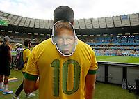 A Neymar mask hangs above his trademark number 10 Brazil shirt