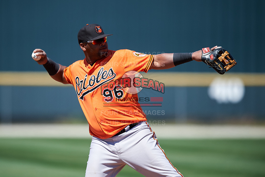 Baltimore Orioles third baseman Juan Francisco (96) throws to first base during a minor league Spring Training game against the Boston Red Sox on March 16, 2017 at the Buck O'Neil Baseball Complex in Sarasota, Florida.  (Mike Janes/Four Seam Images)