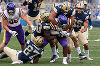 Pitt defensive players Oluwaseun Idowu (23), Rashad Weaver (17), Bricen Garner (27) and Paris Ford (12) gang tackle Albany running back Karl Mofor. The Pitt Panthers football team defeated the Albany Great Danes 33-7 on September 01, 2018 at Heinz Field, Pittsburgh, Pennsylvania.