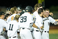 Gavin Sheets (24) of the Wake Forest Demon Deacons is mobbed by his teammates following his game winning hit in the bottom of the ninth inning against the West Virginia Mountaineers in Game Four of the Winston-Salem Regional in the 2017 College World Series at David F. Couch Ballpark on June 3, 2017 in Winston-Salem, North Carolina.  The Demon Deacons walked-off the Mountaineers 4-3.  (Brian Westerholt/Four Seam Images)