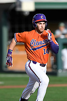 Catcher Kyle WIlkie (10) of the Clemson Tigers runs out a batted ball in a game against the William and Mary Tribe on February 16, 2018, at Doug Kingsmore Stadium in Clemson, South Carolina. Clemson won, 5-4 in 10 innings. (Tom Priddy/Four Seam Images)
