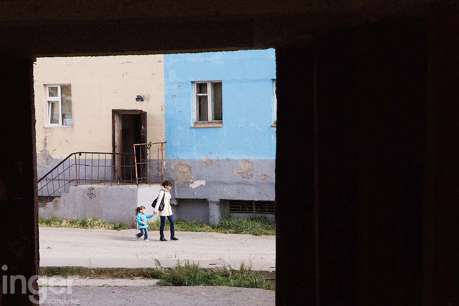 A young Chukchi woman walks the streets of Anadyr with her young daughter