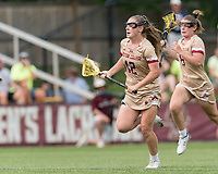 NEWTON, MA - MAY 22: Cassidy Weeks #12 of Boston College brings the ball forward during NCAA Division I Women's Lacrosse Tournament quarterfinal round game between Notre Dame and Boston College at Newton Campus Lacrosse Field on May 22, 2021 in Newton, Massachusetts.