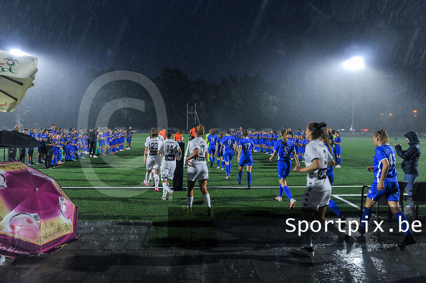 KRC Genk youth welcome the players while they enter the field before a female soccer game between  Racing Genk Ladies and Sporting du pays de Charleroi on the fourth matchday of the 2021-2022 season of the Belgian Scooore Womens Super League , friday 10 September 2021  in Genk , Belgium . PHOTO SPORTPIX | STIJN AUDOOREN