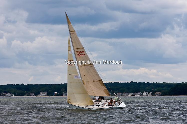 Sailboat under a cloudy sky