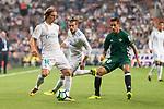 Real Madrid's Luka Modric and Gareth Bale and Real Betis's Cristian Tello during La Liga match between Real Madrid and Real Betis at Santiago Bernabeu Stadium in Madrid, Spain September 20, 2017. (ALTERPHOTOS/Borja B.Hojas)