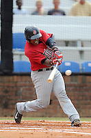 Catcher Brian Navarreto (24) of the Elizabethton Twins bats in a game against the Johnson City Cardinals on Sunday, July 27, 2014, at Howard Johnson Field at Cardinal Park in Johnson City, Tennessee. The game was suspended due to weather in the fifth inning. (Tom Priddy/Four Seam Images)