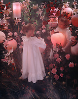 Two young girls lighting lanterns in a garden - inspired by a John Singer Sargent painting.