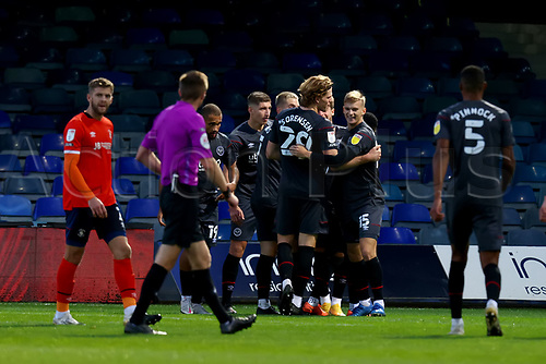 31st October 2020; Kenilworth Road, Luton, Bedfordshire, England; English Football League Championship Football, Luton Town versus Brentford; Marcus Forss of Brentford celebrates with team mates after he scores for 0-3 in the 75th minute