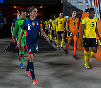 HOUSTON, TX - JUNE 13: Carli Lloyd #10 of the USWNT walks onto the field before a game between Jamaica and USWNT at BBVA Stadium on June 13, 2021 in Houston, Texas.