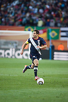 The USA's Carlos Bocanegara dribbles the ball upfield during the USA and Slovenia FIFA World Cup first round match at Ellis Park Stadium in Johannesburg, South Africa on Friday, June 18, 2010.  The USA tied Slovenia 2-2.