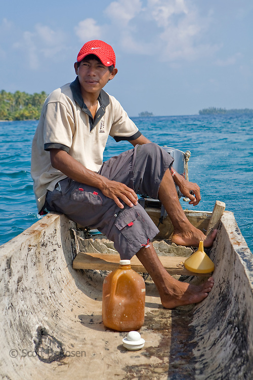 "Local Kuna man on a Cayuko ""dug-out canoe"" in the San Blas Islands, Kuna Yala, Panama"